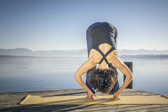Yoga woman lake Stock Photos