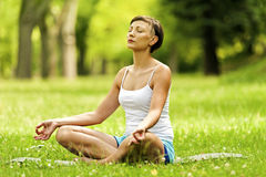 Yoga woman in lotos position with closed eyes. Stock Image