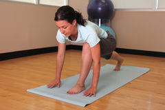 Yoga woman in lunge pose. Yoga woman lunge pose on mat in gym stock photos