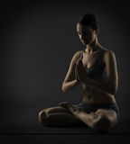 Yoga woman meditate sitting in lotus pose. Silhoue Royalty Free Stock Images
