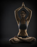 Yoga woman meditate sitting in lotus pose. Silhoue Stock Image