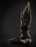 Yoga woman meditate sitting in lotus pose. Silhoue Royalty Free Stock Photos