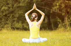 Yoga woman meditates outdoors Stock Photo