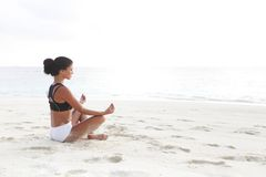 Yoga woman meditating near sea Royalty Free Stock Images
