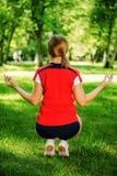 Yoga woman meditating in park Royalty Free Stock Photos