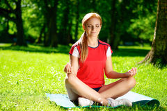 Yoga woman meditating in park Royalty Free Stock Images