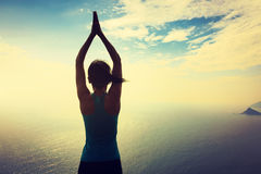 Yoga woman meditation at sunrise seaside Royalty Free Stock Photography