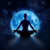 Yoga woman in moon and star. Meditation girl in moonlight. Yoga woman in full blue moon and star. Meditation girl sitting in lotus pose under moonlight in dark stock photos