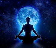 Yoga woman in moon and star. Meditation girl in moonlight. Yoga woman in full blue moon and star. Meditation girl sitting in lotus pose under moonlight in dark royalty free stock image
