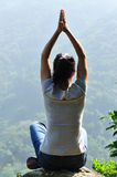 Yoga woman mountain top Royalty Free Stock Photos