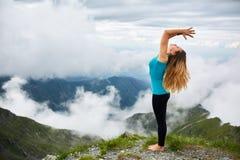 Yoga woman on mountain Royalty Free Stock Photos