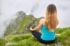 Yoga woman on mountain Stock Images