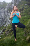 Yoga woman on mountain Royalty Free Stock Images