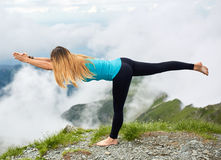 Yoga woman on mountain Stock Images