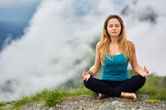 Yoga woman on mountain Royalty Free Stock Photos