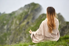 Yoga woman on mountain Stock Photo