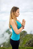 Yoga woman on mountain. Young woman doing yoga on the summit of the mountain Royalty Free Stock Images
