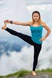 Yoga woman on mountain Stock Image