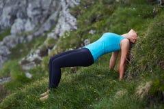 Yoga woman on mountain Stock Photo