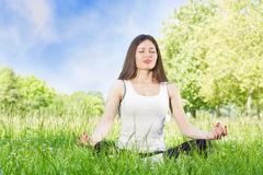 Yoga woman outdoors Royalty Free Stock Photos