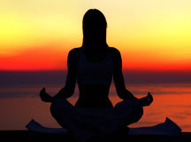 Yoga woman over sunset Royalty Free Stock Photos