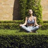 Yoga woman poses in tropics wearing stylish sportswear. Phuket island, Thailand Royalty Free Stock Image