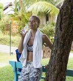 Yoga woman poses in tropics wearing stylish sportswear. Phuket island, Thailand Stock Images