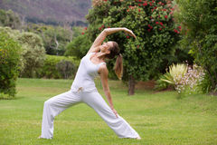 Yoga woman practising outside in park. Full length portrait of a yoga woman practising outside in park Royalty Free Stock Photos