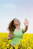 Yoga woman in rape flower field Royalty Free Stock Photo