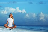 Yoga woman on sea coast Royalty Free Stock Photos