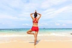 Yoga woman on sea coast Royalty Free Stock Photo