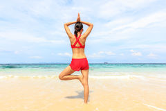 Yoga woman on sea coast. Summer Lifestyle Royalty Free Stock Photography