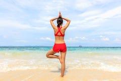 Yoga woman on sea coast Stock Photography