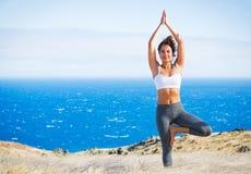 Yoga woman in a seashore Stock Image