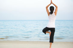 Yoga woman seaside Stock Image