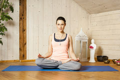 Yoga woman siddhasana Royalty Free Stock Images