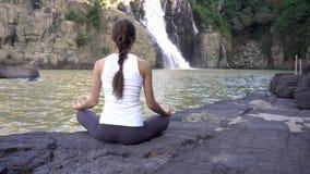 female in meditation yoga woman lotus pose back view