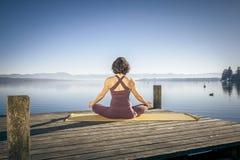 Yoga woman sitting lake Stock Image