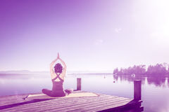 Yoga woman sitting lake Stock Photography