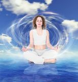 Yoga woman on sky water background collage. Yoga woman in white dress on sky water background collage Stock Photo