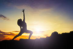 Yoga woman sunrise Royalty Free Stock Photography