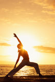 Yoga Woman at Sunset Stock Images