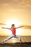 Yoga Woman at Sunset Royalty Free Stock Photography
