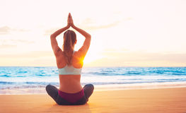 Yoga Woman at Sunset. Woman practicing yoga on the beach at sunset Royalty Free Stock Images
