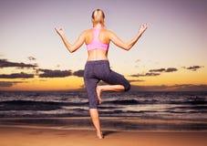 Yoga woman at sunset Stock Photography