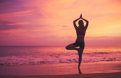 Yoga Woman at Sunset Royalty Free Stock Image