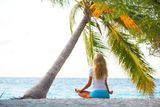Yoga woman under palm Royalty Free Stock Image