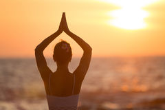 Yoga by woman Royalty Free Stock Images