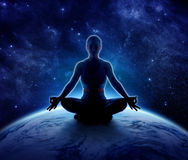 Yoga woman on the world. Meditation girl on planet earth royalty free stock images