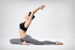 The yoga woman. Young beautiful yoga posing  on a studio background Royalty Free Stock Images